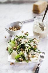 Caesar Salad with roasted cashews on plate - SBDF001001