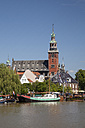 Germany, Lower Saxony, Leer, view to town hall with museum harbour in front - WIF000922