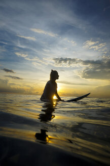 Indonesia, Bali, Canggu, silhouette of female surfer by twilight - FAF000056