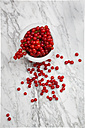 Bowl of red currants, Ribes rubrum, on white marble, elevated view - LVF001651