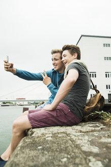 Two happy friends taking selfie outdoors - UUF001398