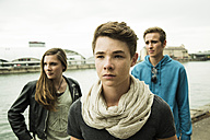 Portrait of three serious teenagers outdoors - UUF001411
