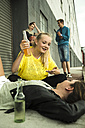 Friends relaxing outdoors - UUF001417