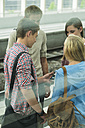Friends talking at commuter train station - UUF001425
