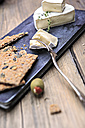 cheese plate and olives on chopping board - VTF000342