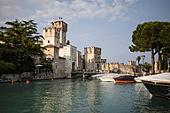 Italy, Lombardy, Sirmione, harbour and city walls - SBDF001139