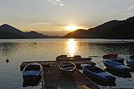 Austria, Salzburg State, Fuschlsee Lake, Fuschl am See, Jetty at sunset - SIEF005685