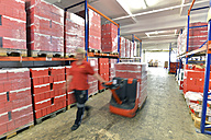 Germany, Saxony-Anhalt, woman working in the storage of a baking factory - LYF000245