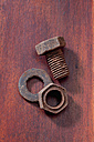 Screw, female screw and cog made of chocolate lying on wood - CSF022015