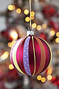 Christmas bauble hanging in front of blurred flares - CSF022033