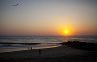 France, Aquitaine, Capbreton, people relaxing on the beach at sunset - FAF000040
