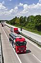 Germany, Saxony, Trucks on motorway - LY000217
