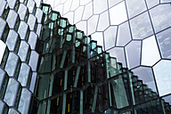 Island, Reykjavik, reflection on glass facade of Harpa concert hall, partial view - FCF000337