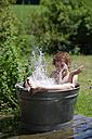 Boy splashing in a zinc tub - LBF000880
