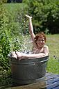 Happy boy splashing in a zinc tub - LBF000879