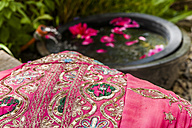 Embroidered cushion and petals in water - TCF004142