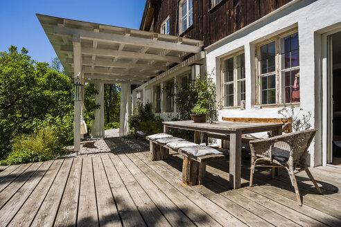 Wooden terrace in sunlight - TCF004191