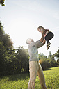 Father scooping his little daughter up in the air - UUF001550