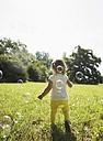 Little girl walking on a meadow, back view - UUF001528