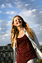 Germany, Berlin, portrait of smiling young woman - FX000055
