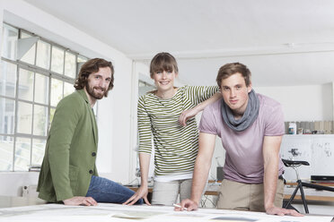 Group picture of three colleagues in a creative office - RBF001762