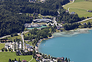 Austria, Salzburg State, Salzkammergut, Fuschl am See, View to Seaside Resort and Red Bull Headquarter at Lake Fuschlsee - SIEF005732