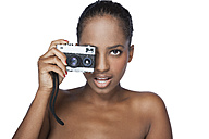 Portrait of woman with camera in front of white background - KDF000488
