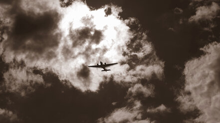 Airplane Junkers JU 52 flying in front of dramatic sky - BSC000440