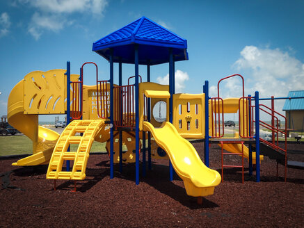Jungle gym with several slides on a public children's playground, Texas, USA - ABAF001448