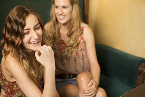 Two female friends having fun in a coffee shop - FCF000381