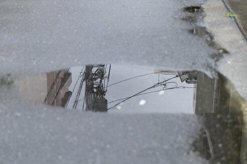 Japan, Tokyo, Shinjuku, power pylon reflecting in puddle - HLF000671