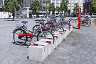 Germany, Berlin, parking station of rental bikes at Potsdam Square - WI000940
