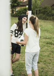 Two young girls having fun on a soccer field - UUF001569