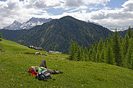 Italy, Alto Adige, man resting in the Campill valley - LB000911