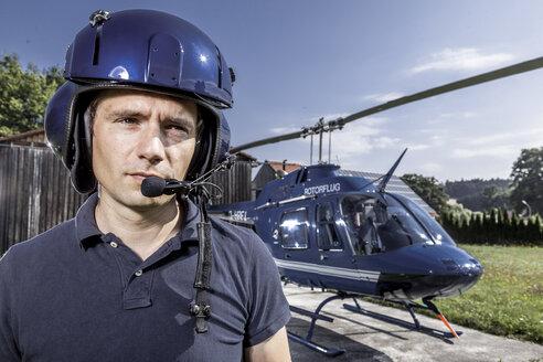 Germany, Bavaria, Landshut, Helicopter pilot wearing helmet - KDF000062