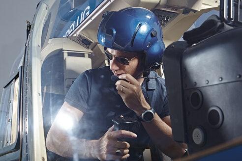 Germany, Bavaria, Landshut, Helicopter pilot in cockpit - KDF000045