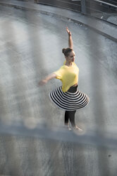 Young ballet dancer exercising on a parking level - UUF001625