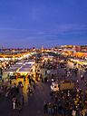 Africa, Morocco, Marrakesh-Tensift-El Haouz, Marrakesh, View over market at Djemaa el-Fna square in the evening - AM002626