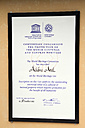 Seychelles, Praslin Island, Certificate of the UNESCO at the entrance of Vallee de Mai - KRP000714
