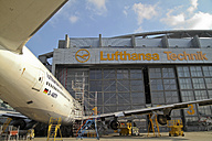 Germany, Hamburg, Lufthansa Technik Hangar at Hamburg Airport with plane - KRP000779