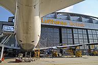 Germany, Hamburg, Lufthansa Technik Hangar at Hamburg Airport with plane - KRP000780