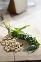 Chopped ramson and pine nuts on chopping board - ASF005465