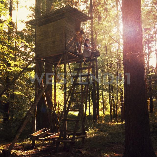 Germany, Baden-Wurttemberg, Tubingen, Children playing in forest - LVF001773
