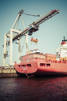 Germany, Hamburg, Port of Hamburg, Container ship and container crane - KRP000959