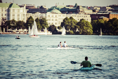 Germany, Hamburg, View of people rowing and sailing on the Alster lake - KRP000961