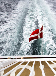 Denmark, Danish flag on ferry on the sea - NGF000147