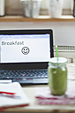 Green smoothie on desk with laptop - SBDF001180