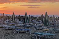 Italy, Friuli-Venezia Giulia, Province of Udine, Lignano Sabbiadoro, Beach and sun loungers in the evening - GFF000535