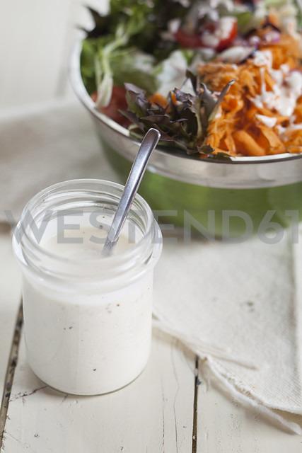 Bowl of mixed salad and glass of yoghurt salad dressing - SBDF001229