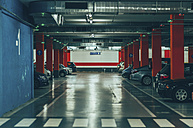 Parking garage with red poles - JP000009